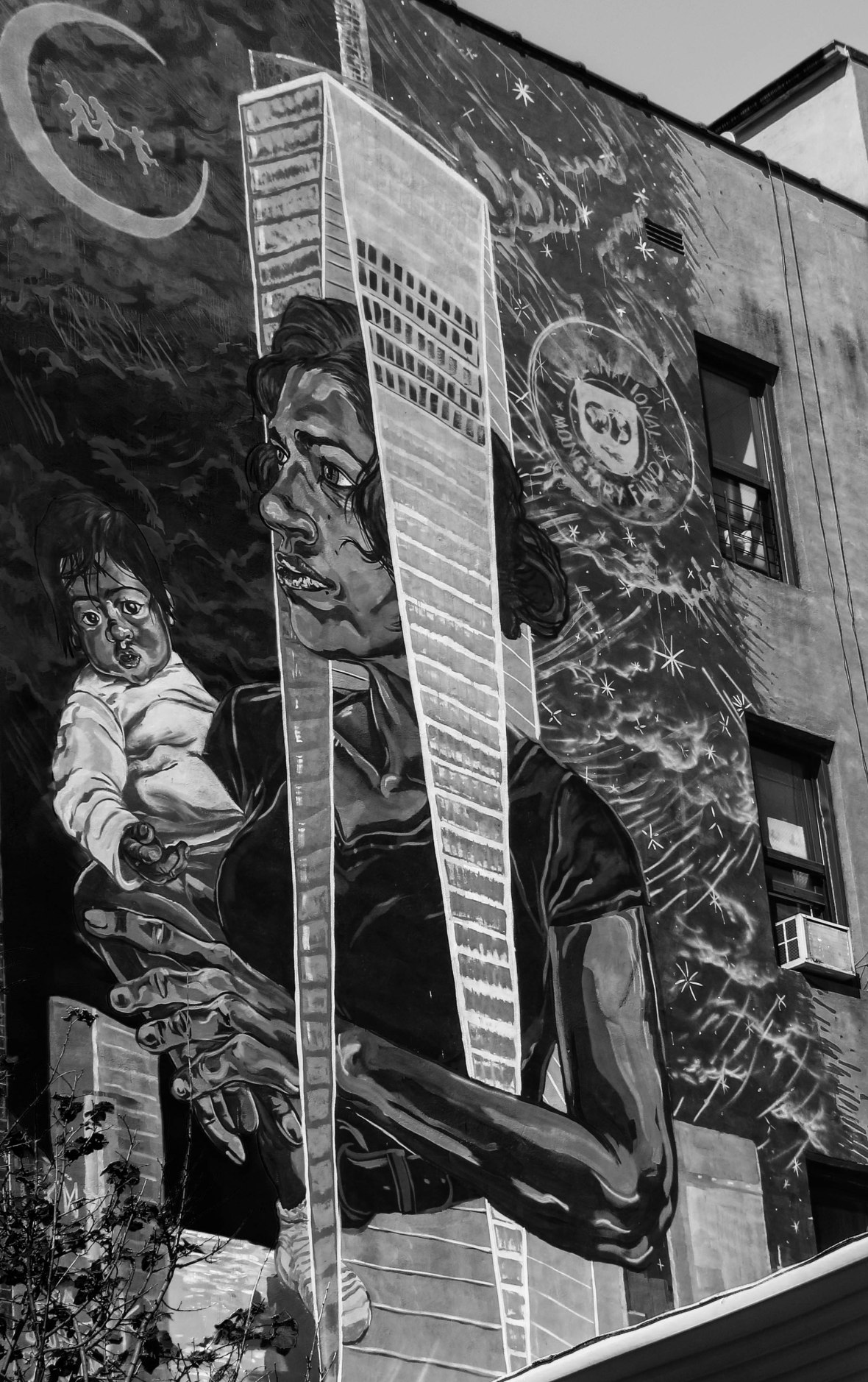 Public Mural: Woman wears Freedom Tower holding child